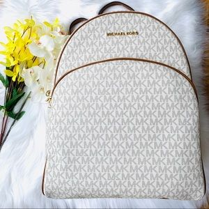 MICHAEL KORS LARGE ABBEY VANILLA CANVAS BACKPACK